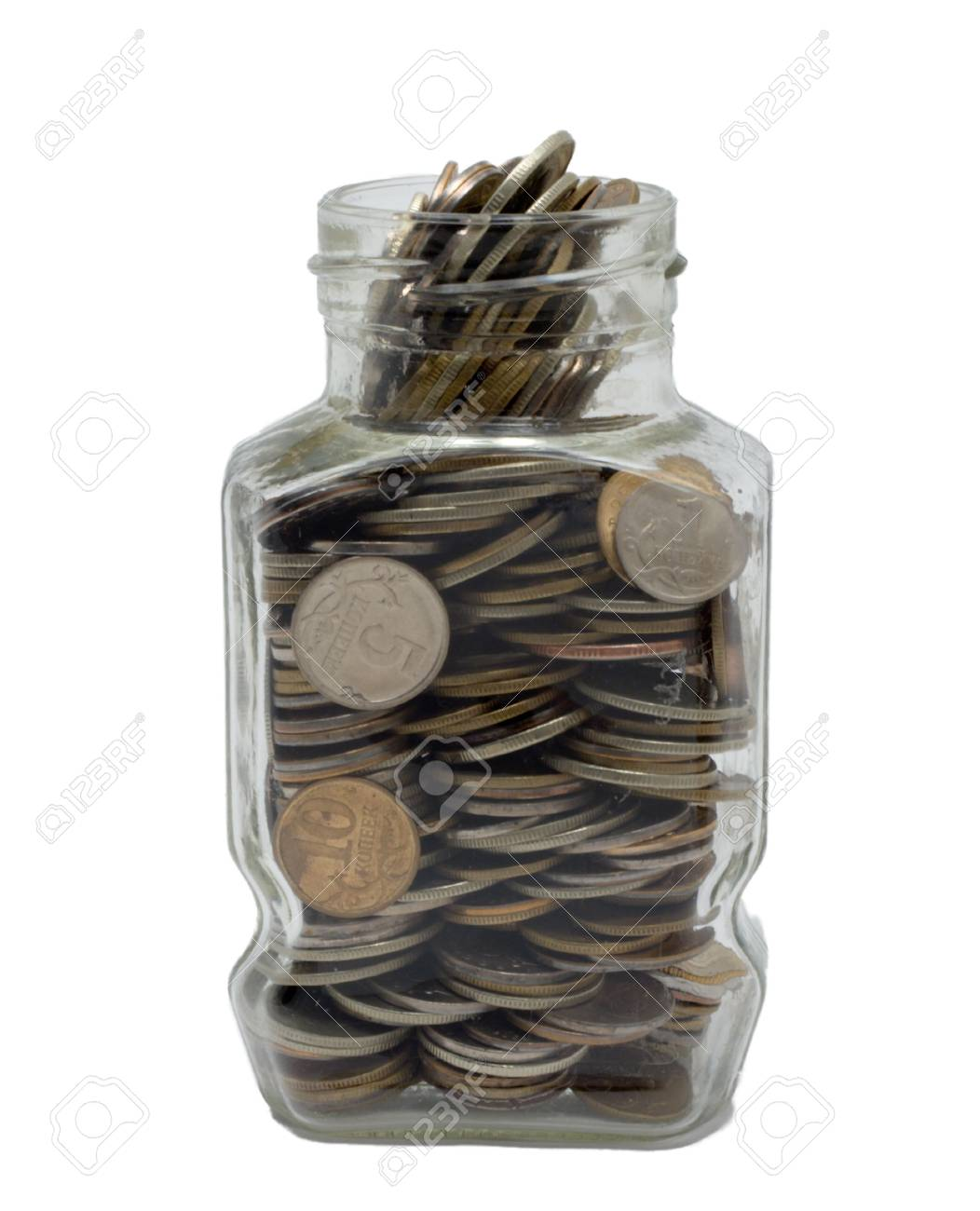 Glass bank with metal coins. Stock Photo - 2678932