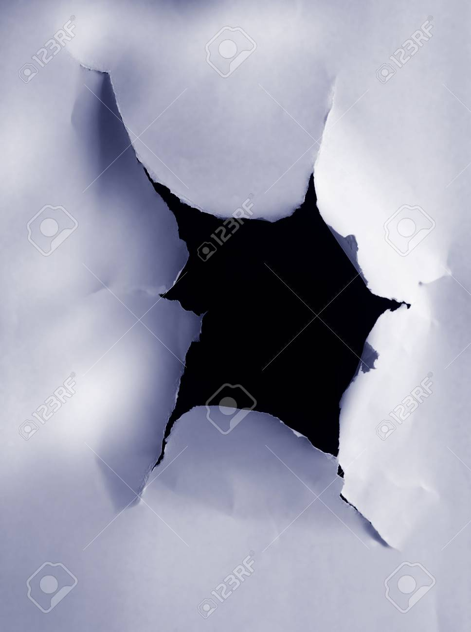A hole torn in a peice of paper Stock Photo - 2147590