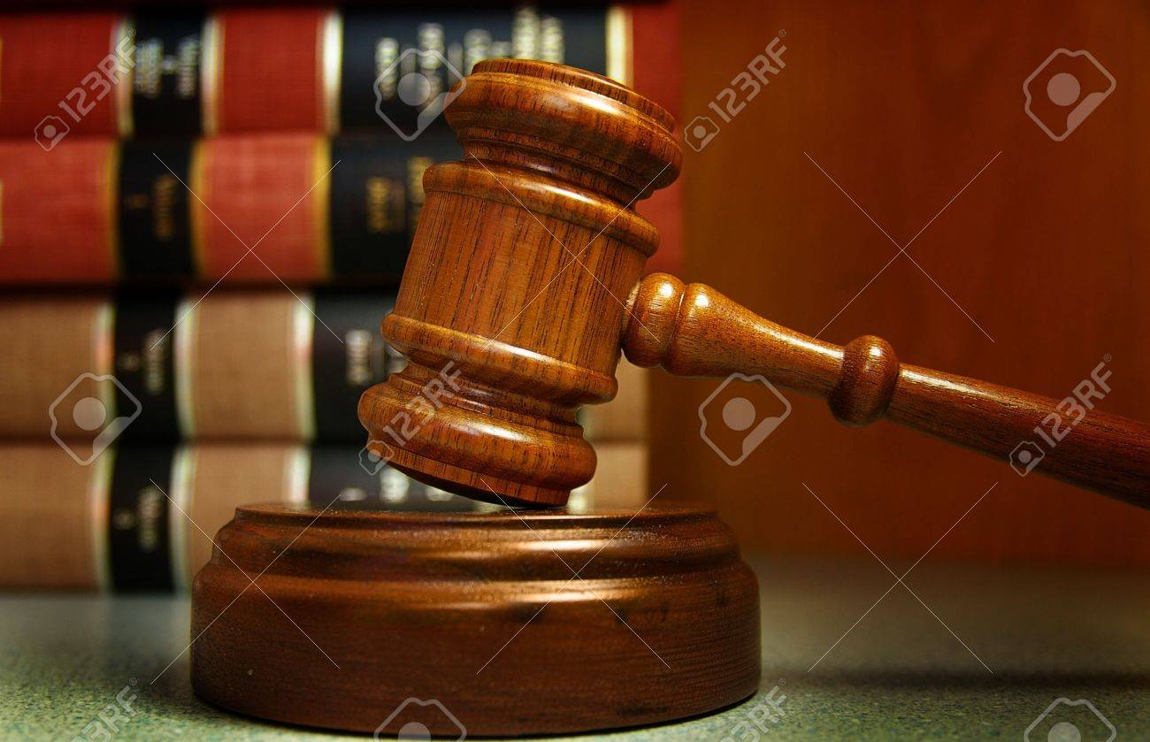 Judges Gavel And Law Books Stacked Behind Stock Photo