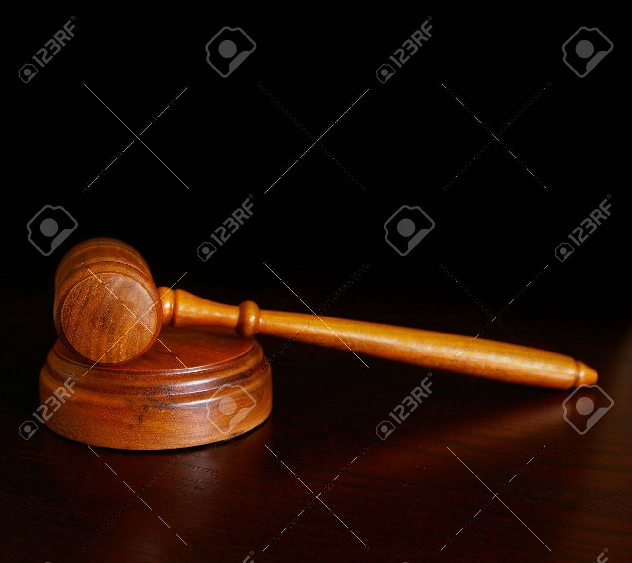 court gavel on desk over dark background stock photo picture and