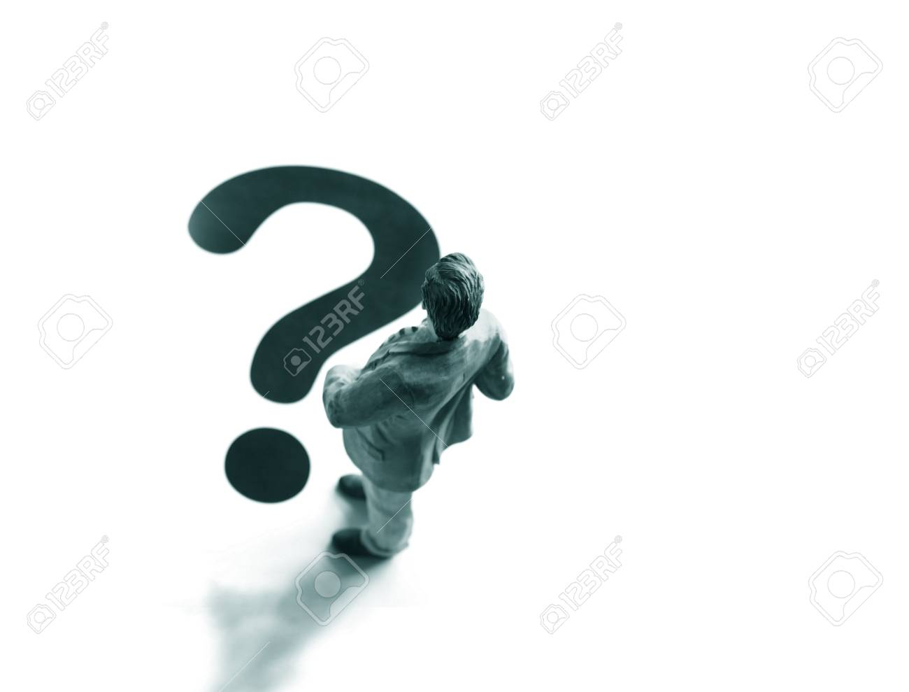 business man figure in front of a question mark Stock Photo - 6508177