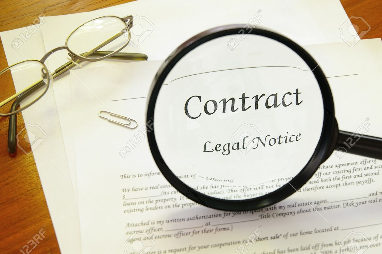 Legal Contract With Magnifying Glass And Glasses Stock Photo ...