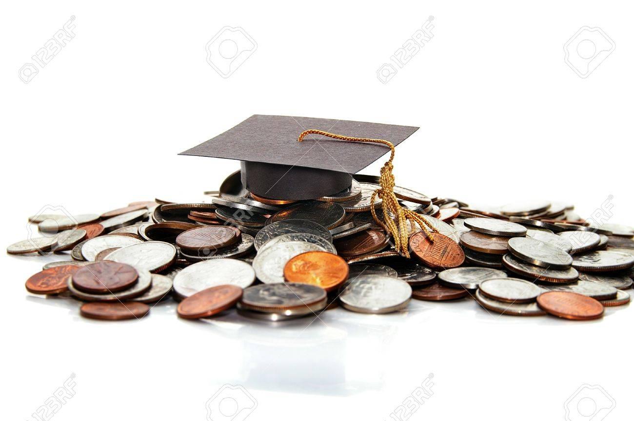 graduation cap  on a pile of money ( student debt ) Stock Photo - 11267113