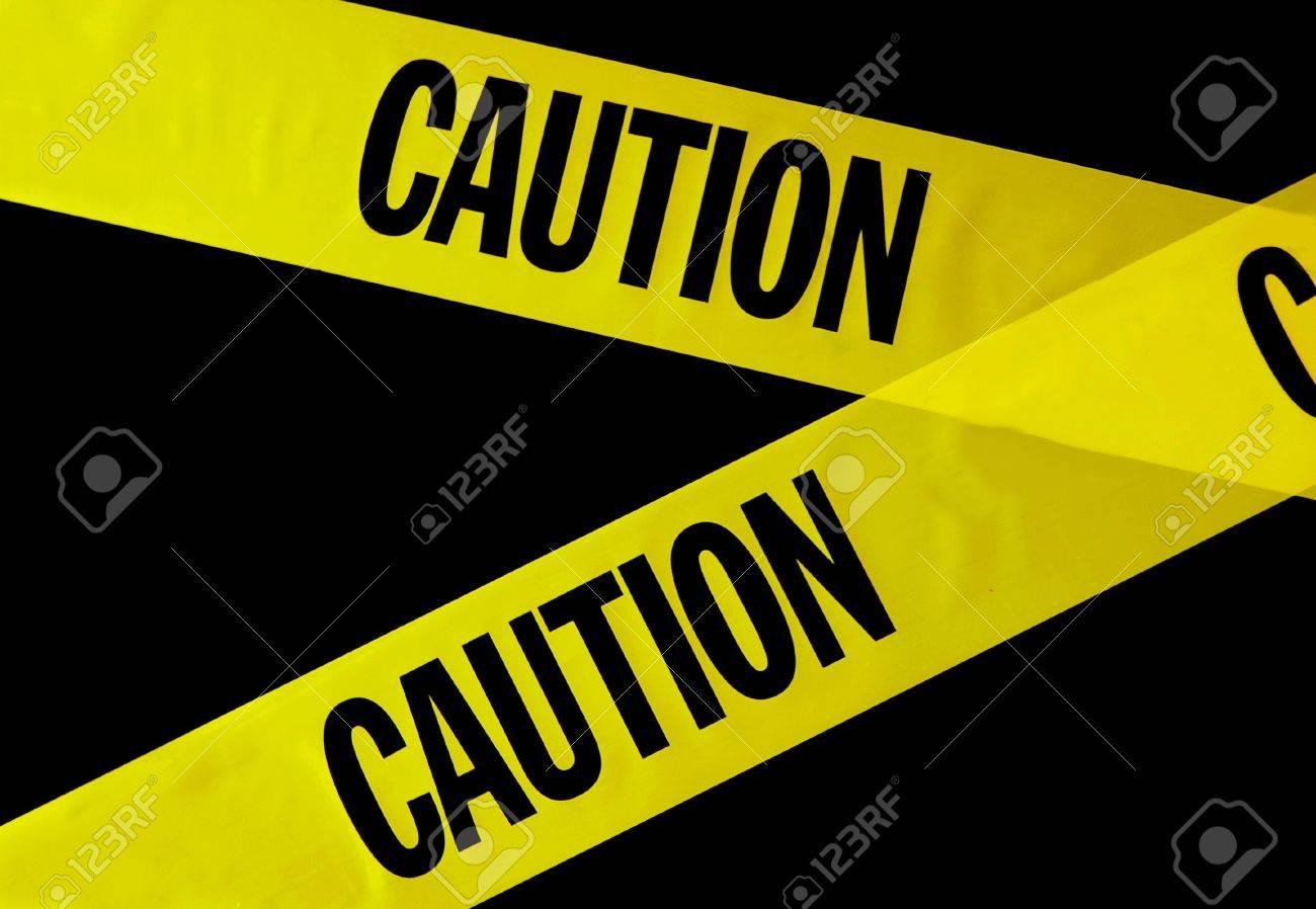 yellow caution tape on black background Stock Photo - 13216208