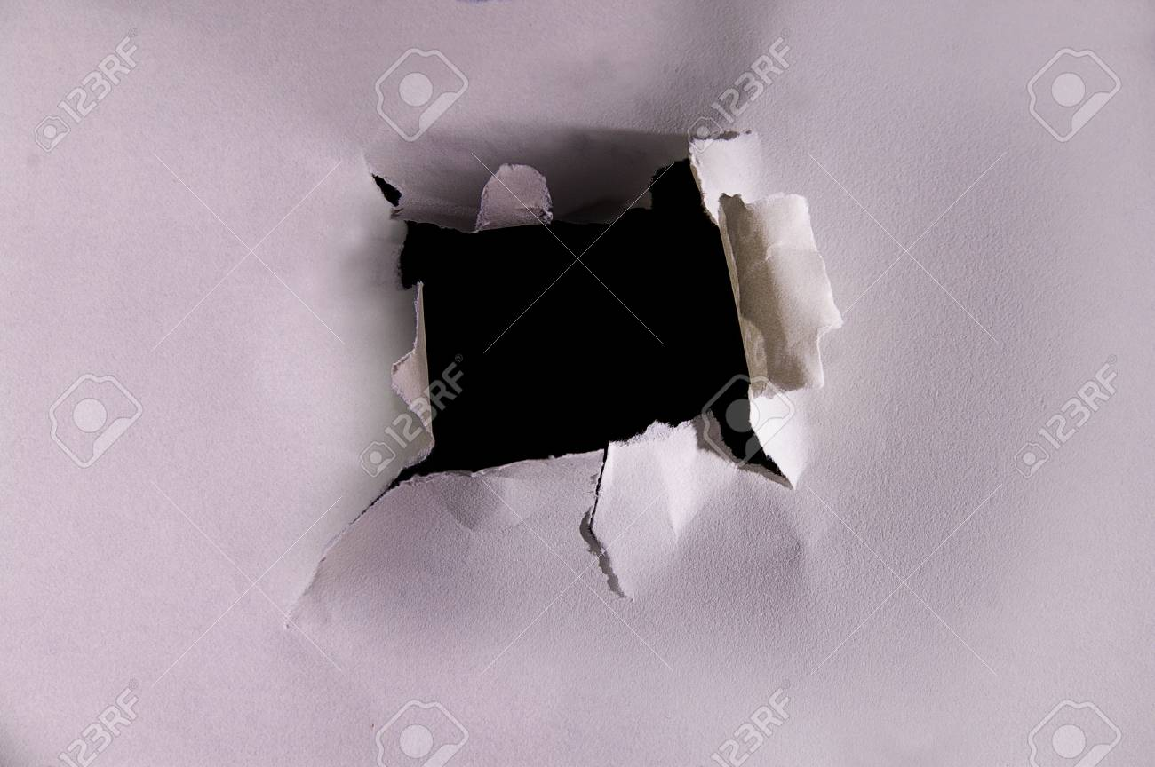 torn hole in a piece of textured paper Stock Photo - 13746695