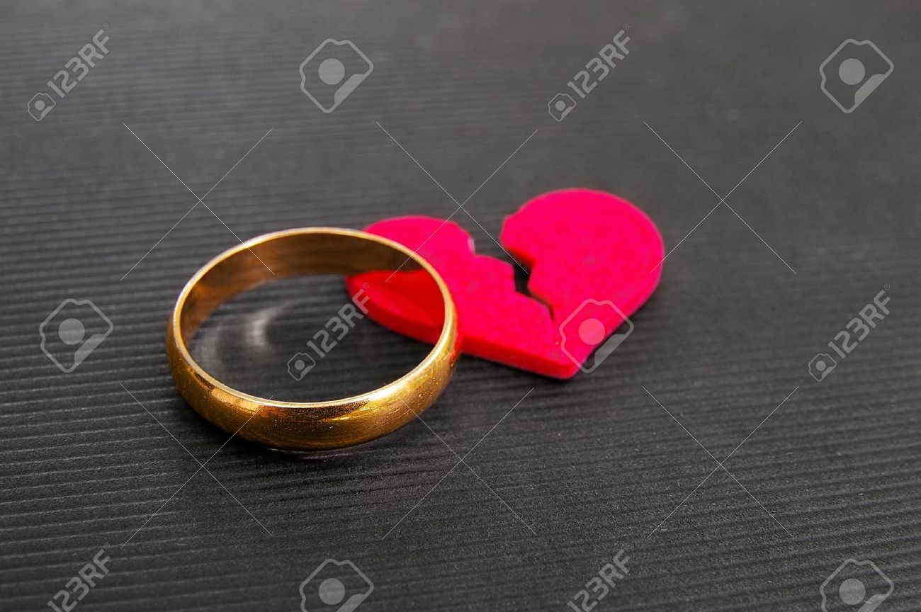 Gold Wedding Ring And Red Broken Heart Divorce Concept Stock Photo