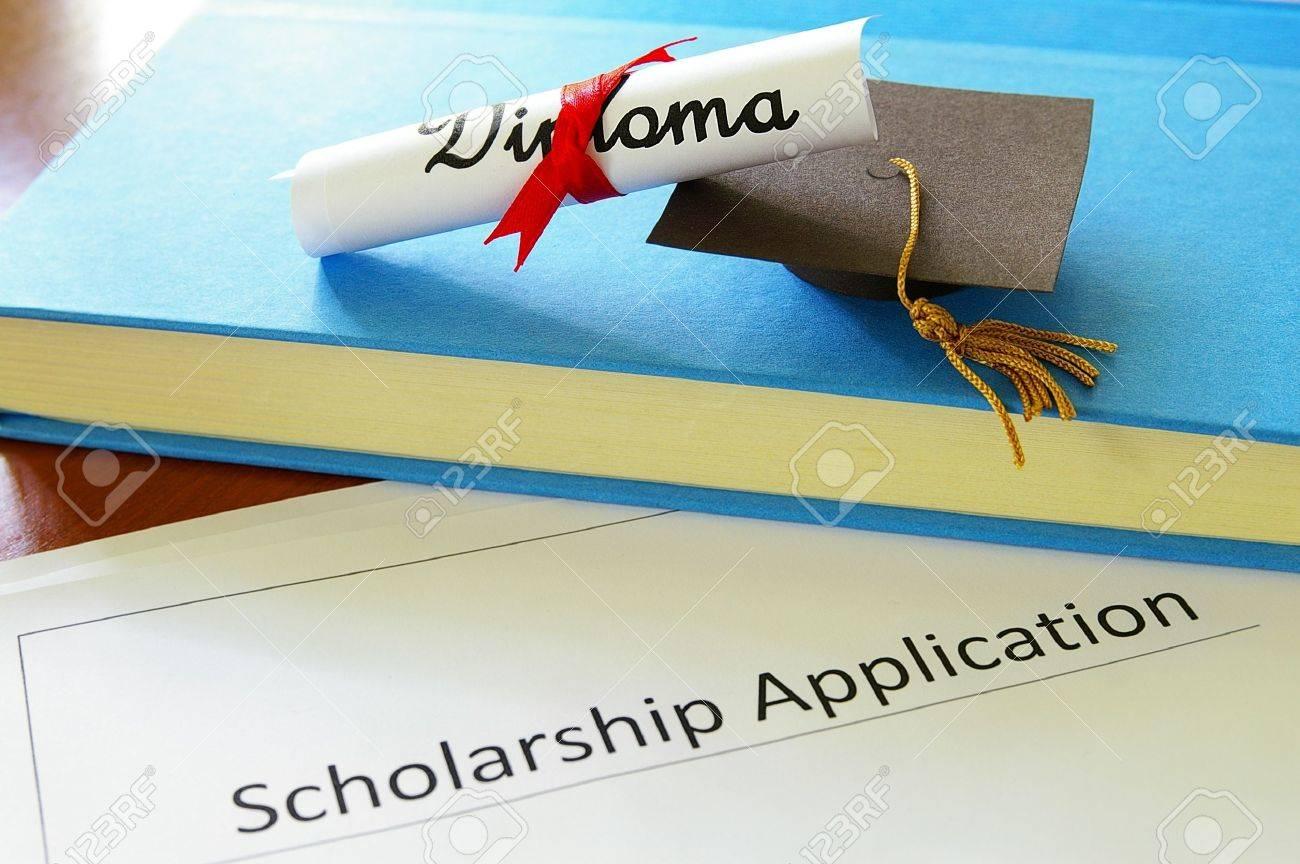 mini graduation mortar board and diploma with scholarship application - 15081721