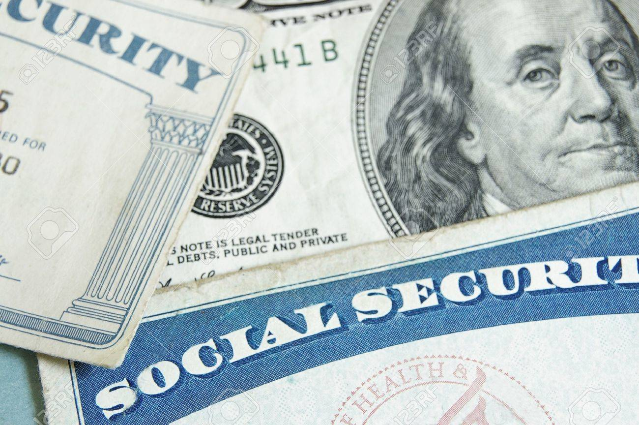social security cards and US money - retirement concept - 15173891