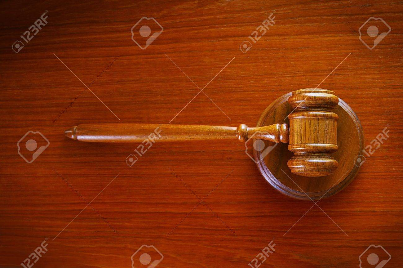 legal court gavel on a desk, top view - 15380420