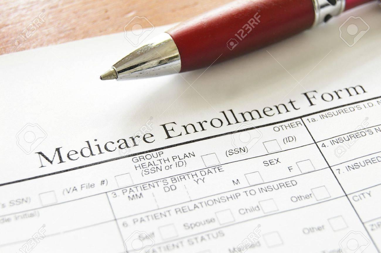 Closeup of Medicare enrollment form and pen - 15815624