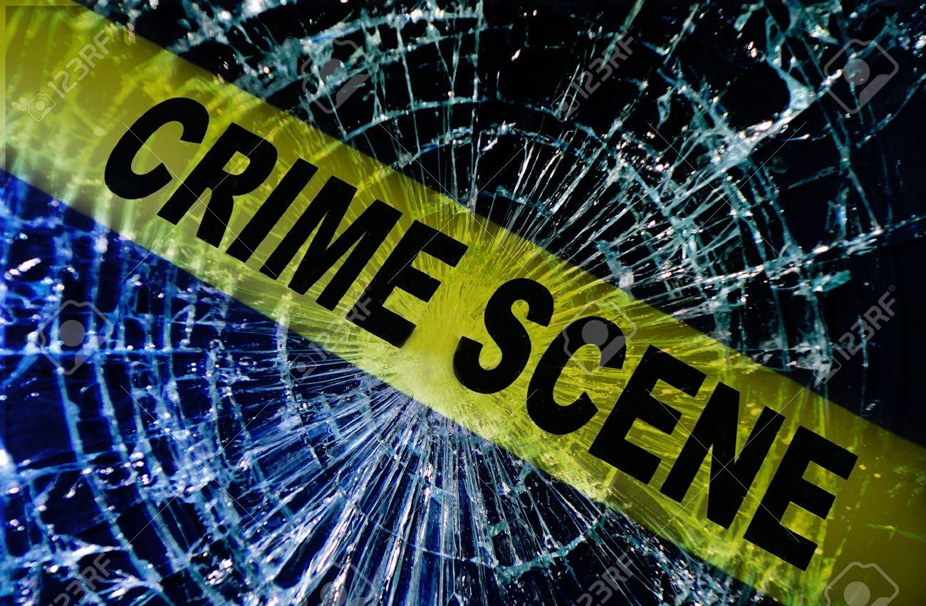 Broken window with yellow Crime Scene tape - 17337642