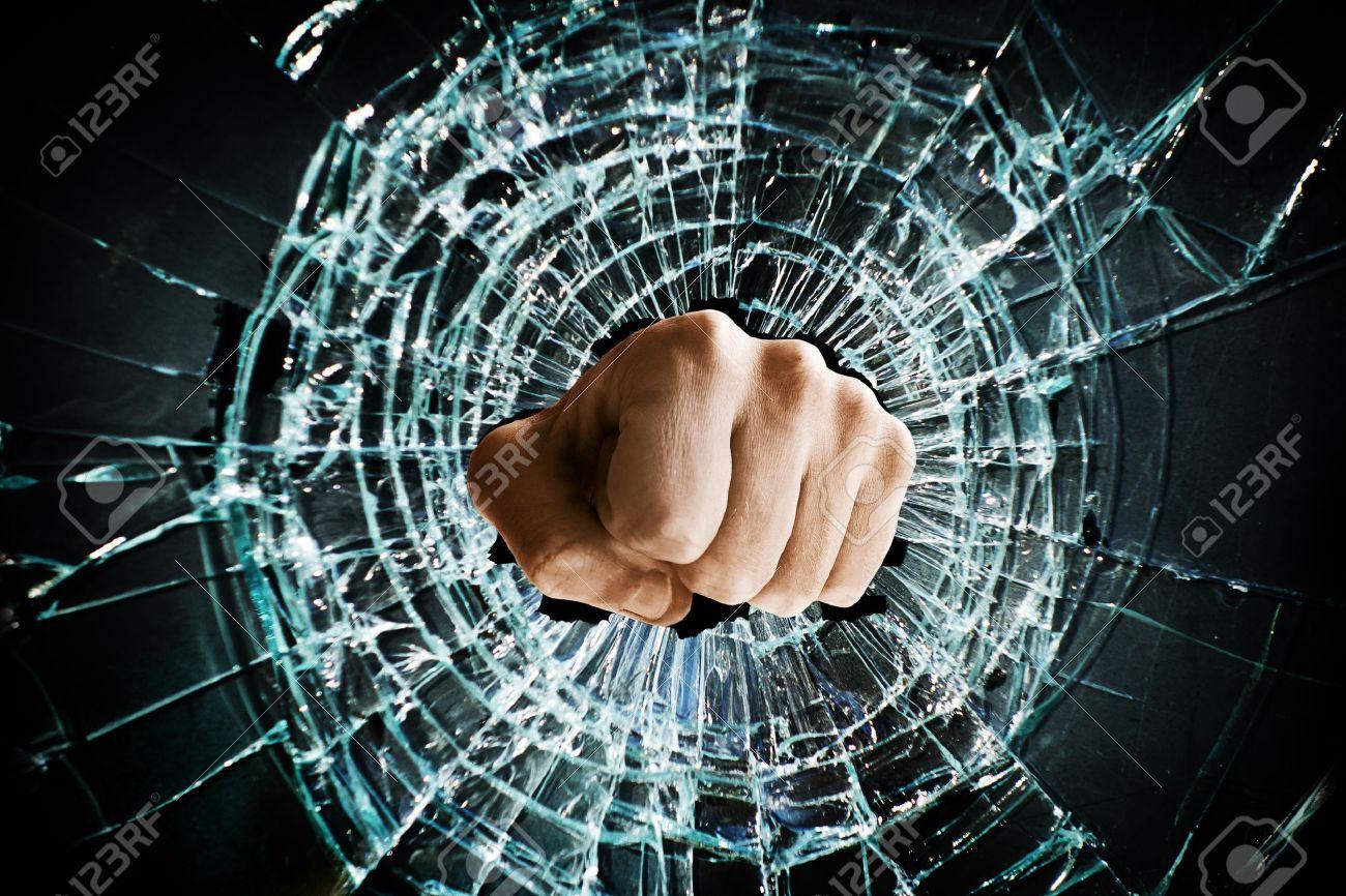 Fist punching thru a glass window Stock Photo - 17337645