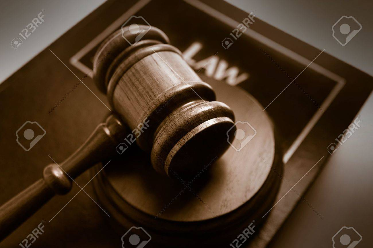 court gavel on top of a law book - 17613198