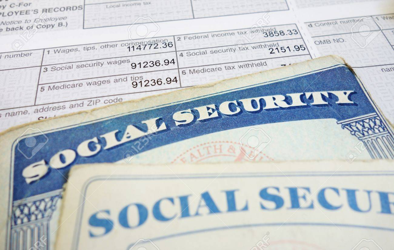 Closeup of Social Security cards and W2 wage form - 17745083