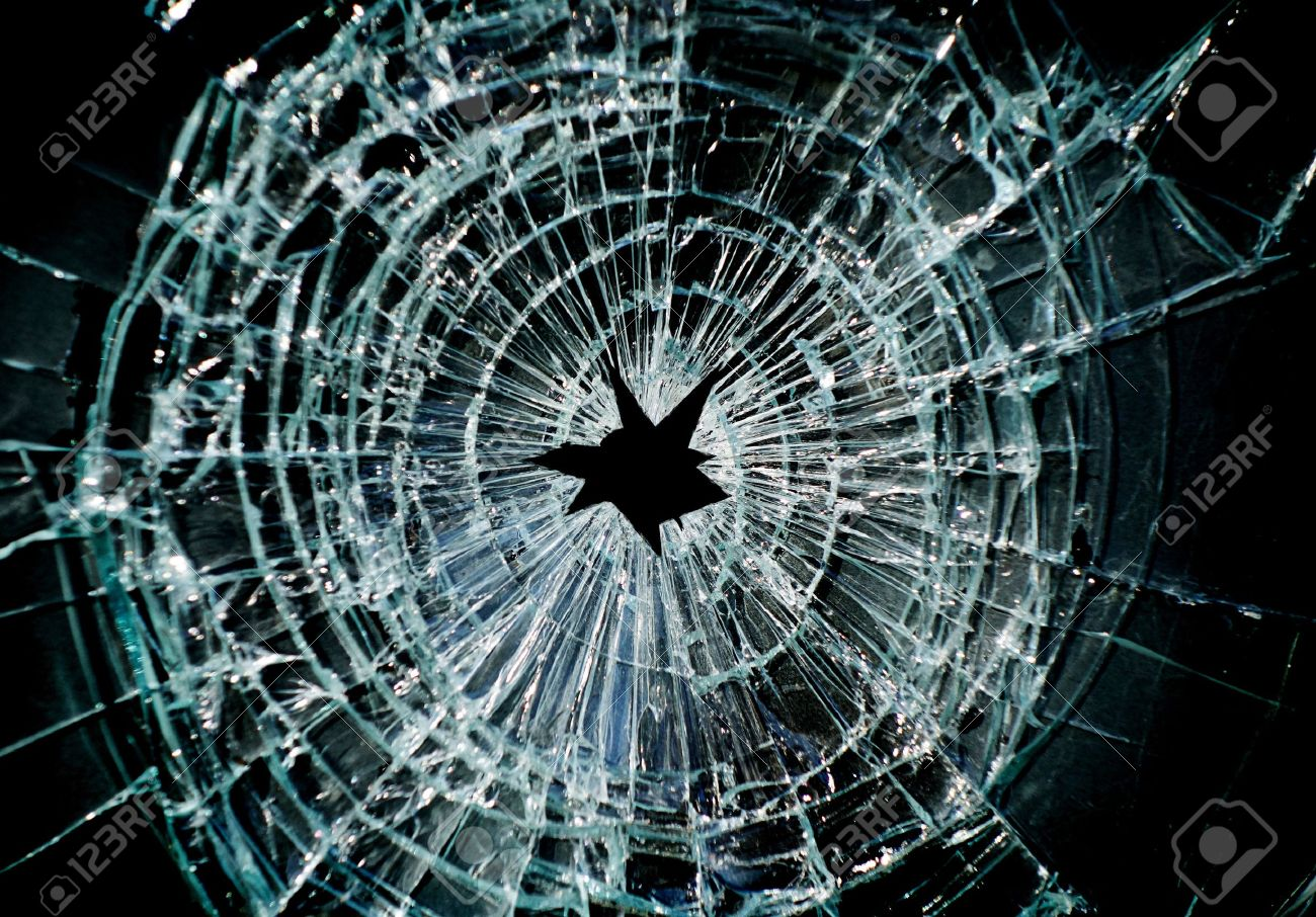 Broken window with a hole in the middle - 18286715