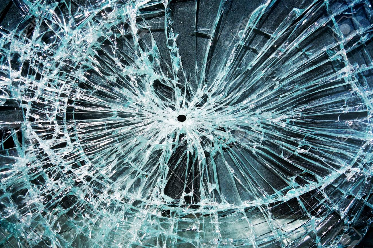 shattered glass with a hole in the middle - 18956028