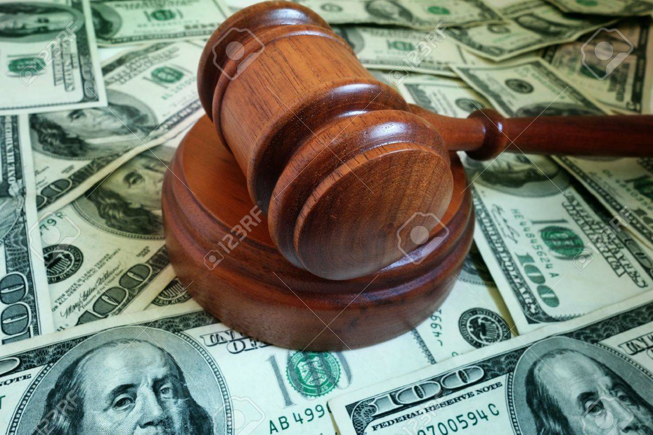 closeup of a legal gavel on US cash - 18955969