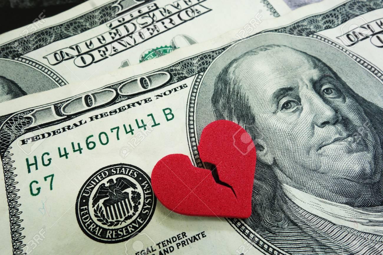closeup of a broken red heart on cash - divorce concept - 20787308