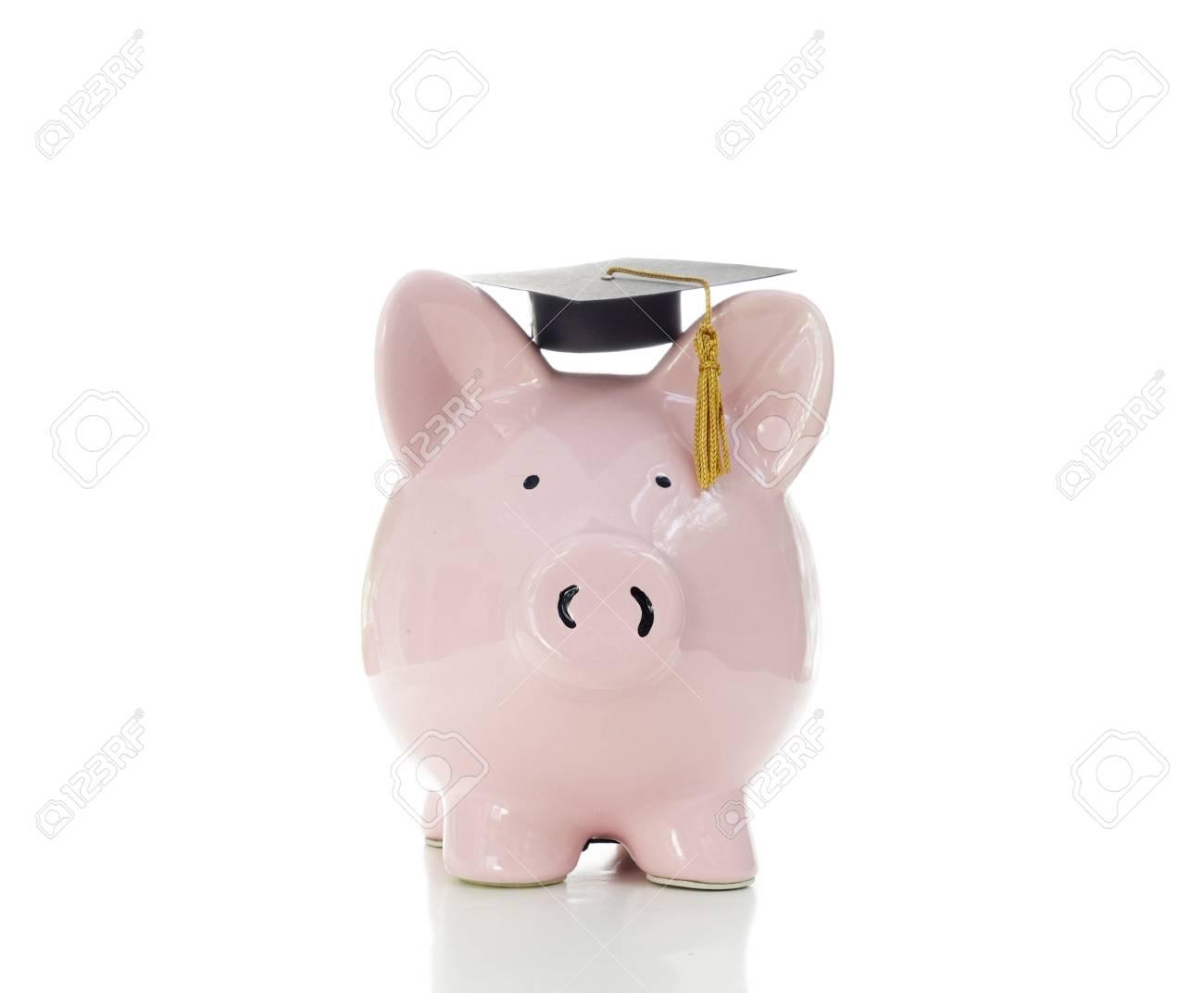 piggy bank wearing a graduation cap, on white Stock Photo - 20787309