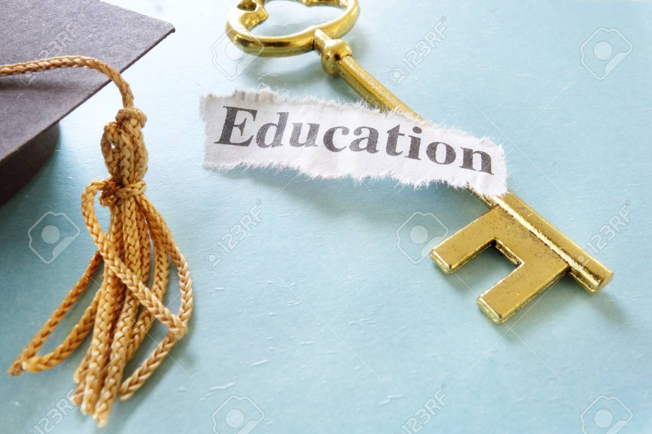 Education note on a golden key, with graduation cap - 23994974