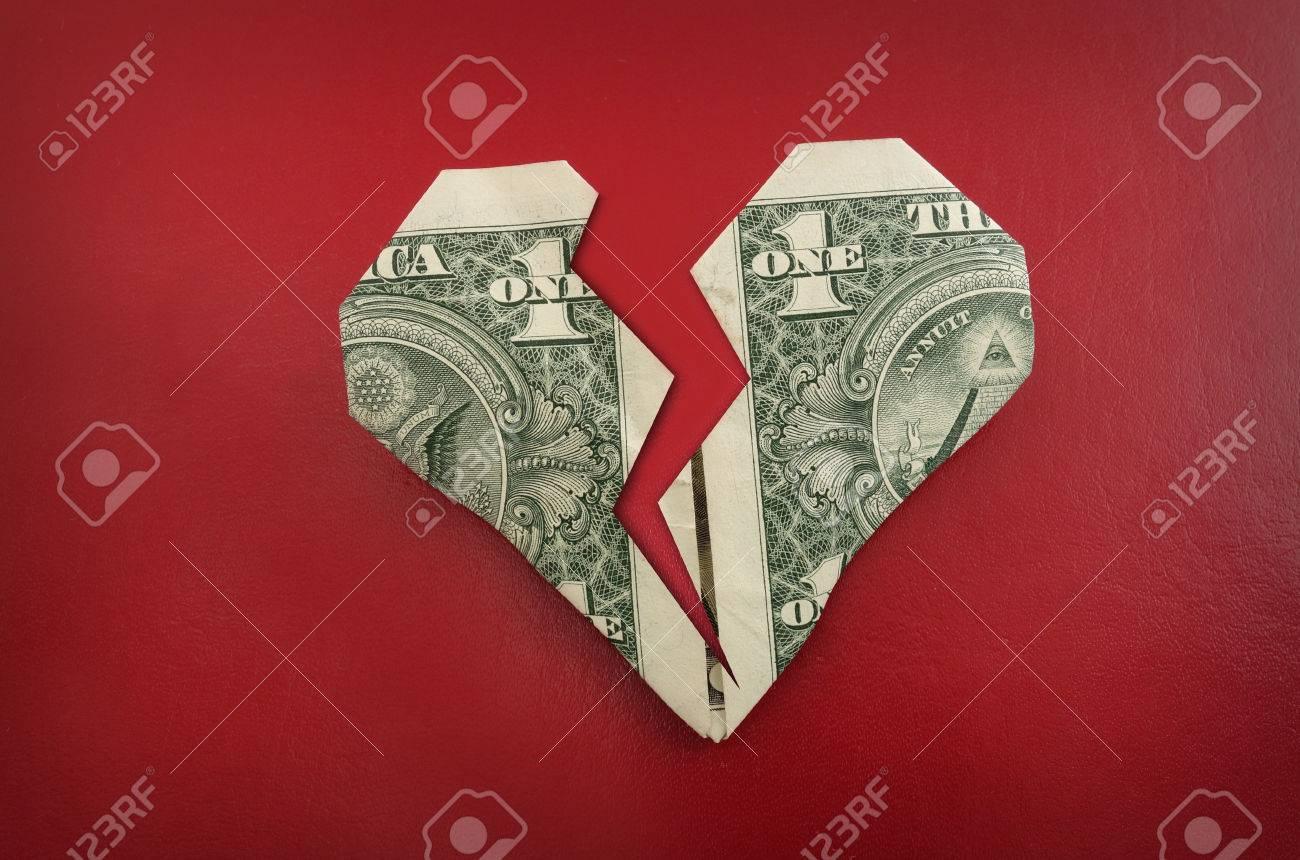 A broken origami dollar heart, on red - 24845266