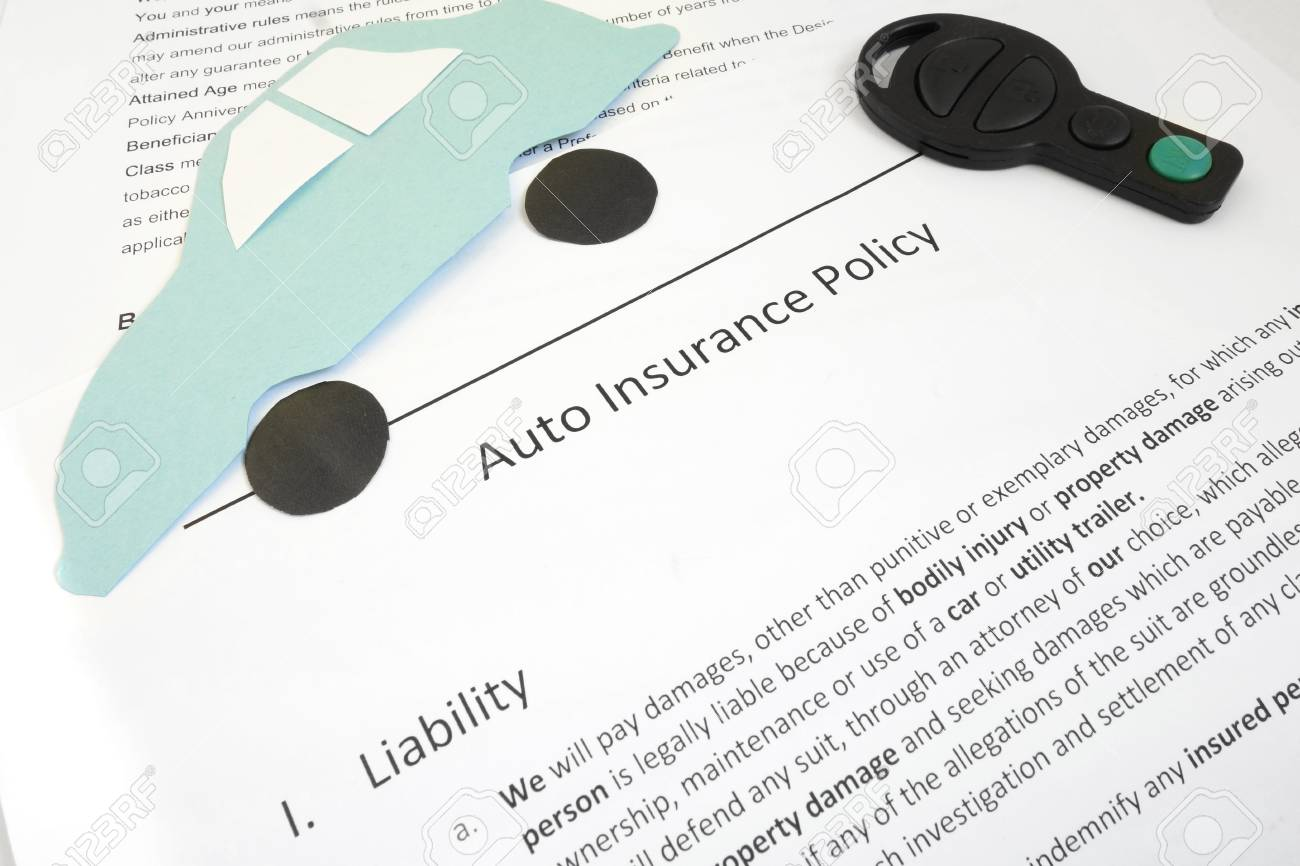 Auto Insurance Policy And Key With Paper Car Stock Photo Picture