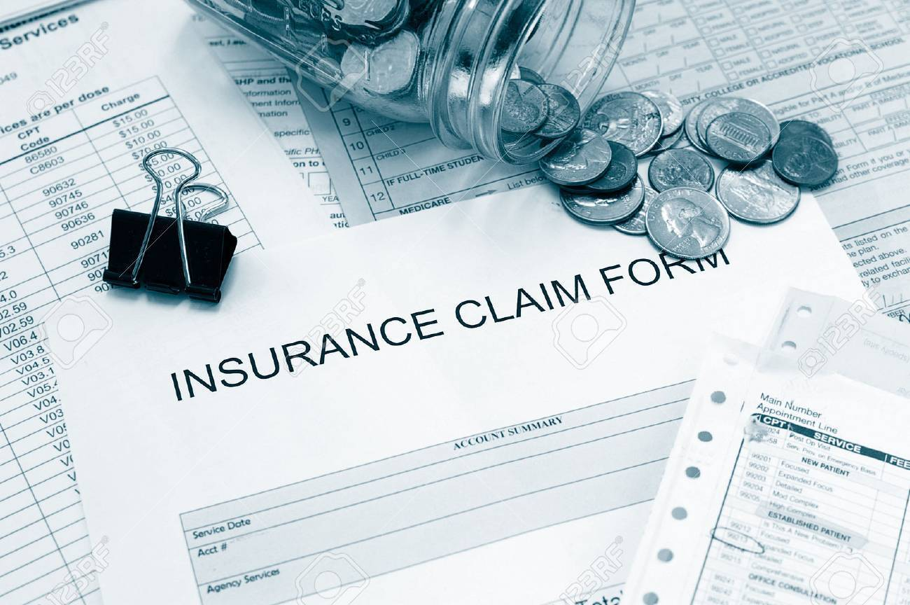 Assorted medical bills and a claim form with coins - 28467662