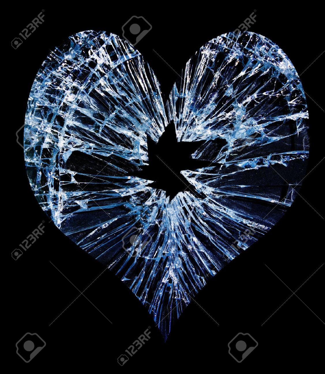 heart shaped shattered glass with a hole in the middle - 29100127