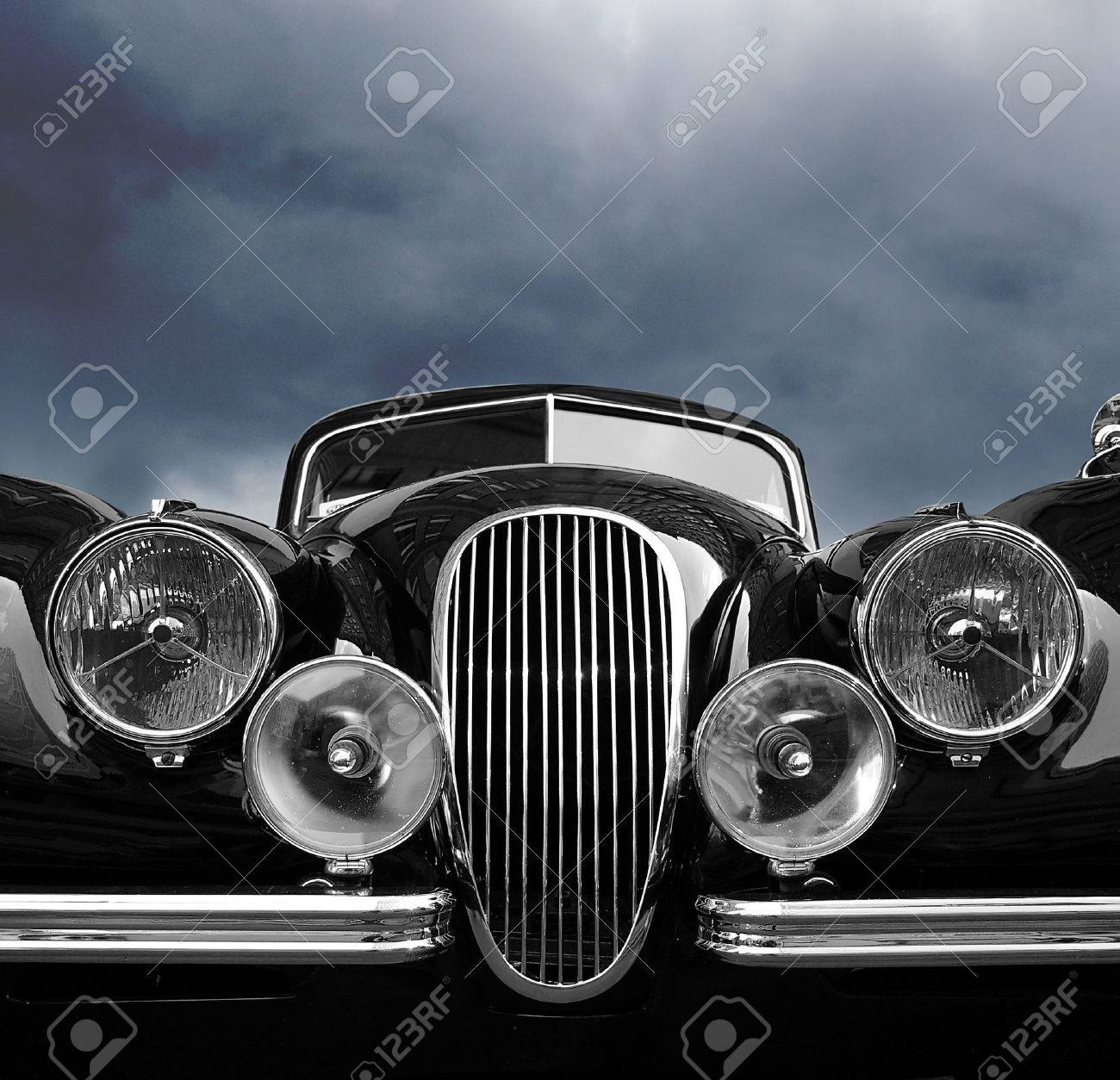 Vintage car front view with dark clouds - 31778861