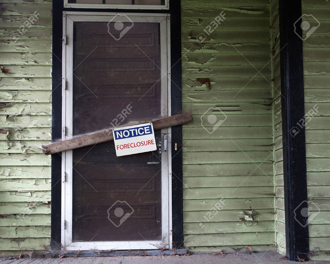 An old vacant house with Foreclosure sign on door - 31863696