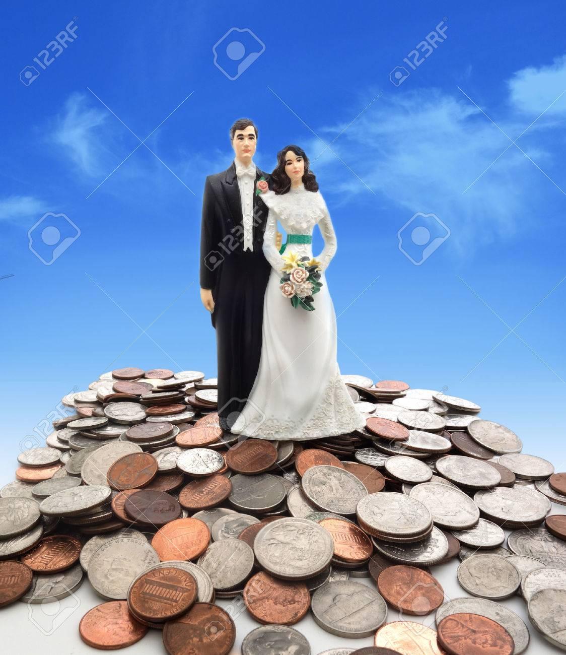 Plastic wedding couple on coins - money concept - 33705255