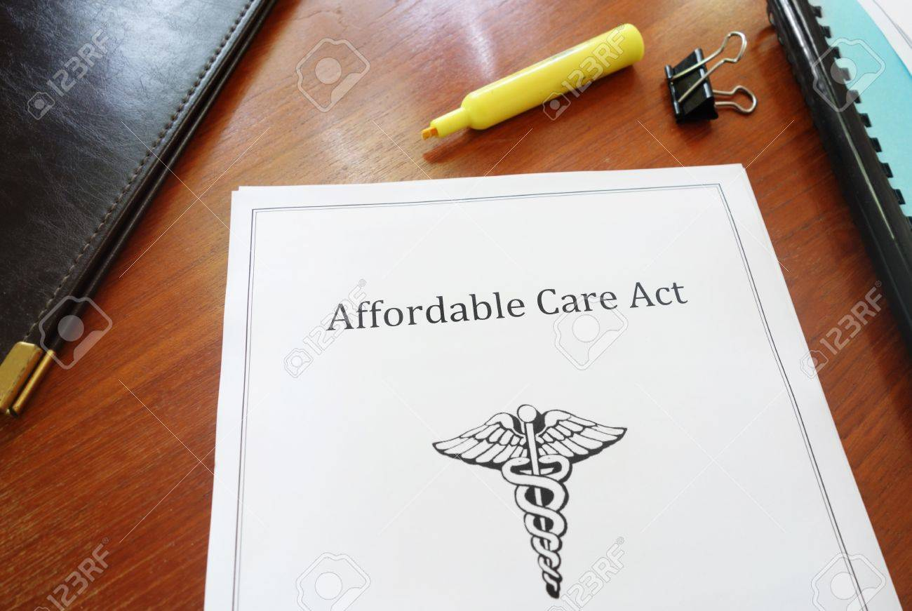 Affordable Care Act document on an office desk Stock Photo - 40883561
