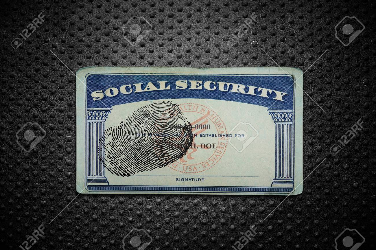 Social Security card with fingerprint on textured metal background