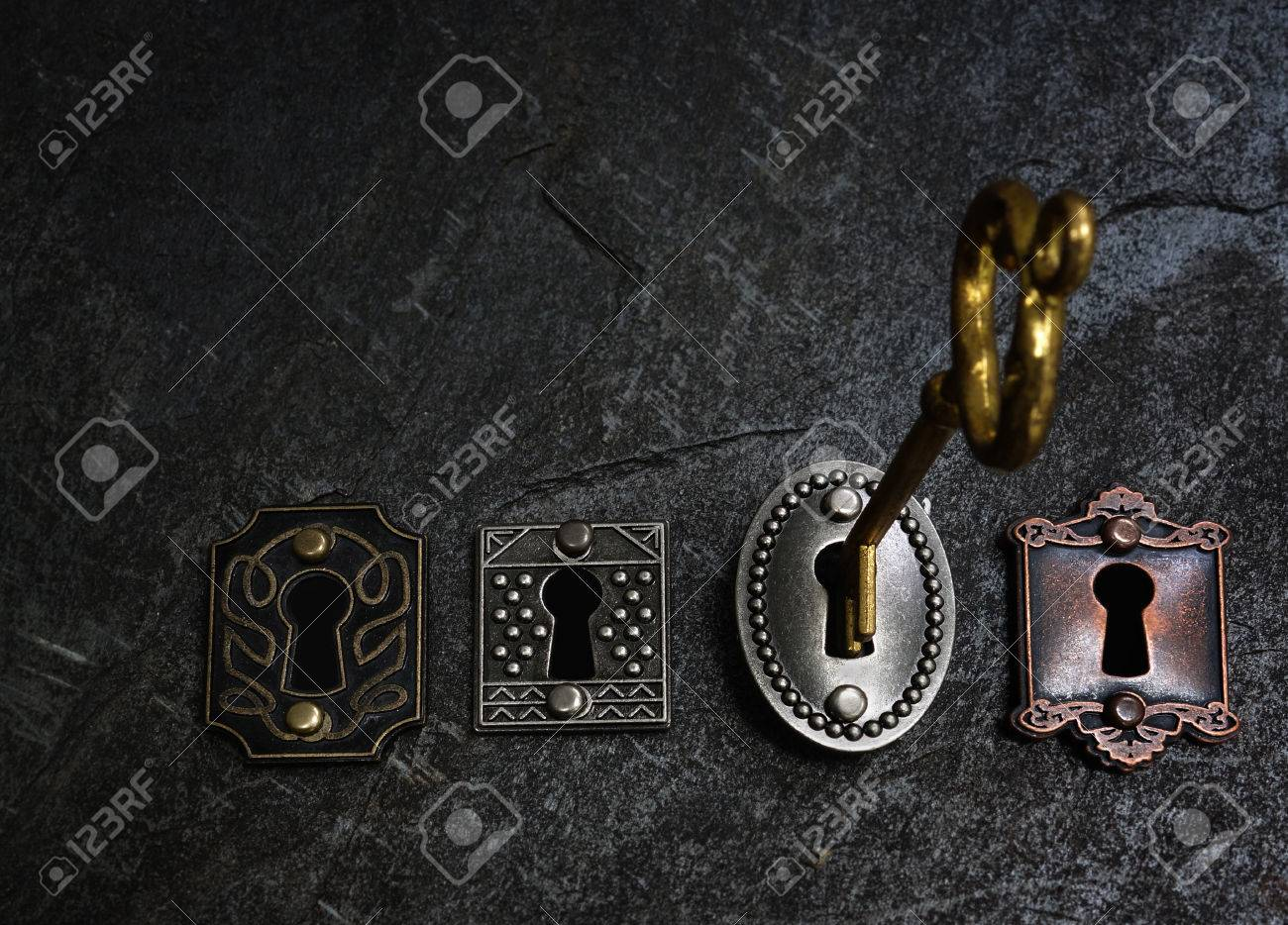 vintage gold key opening one of four old locks stock photo picture