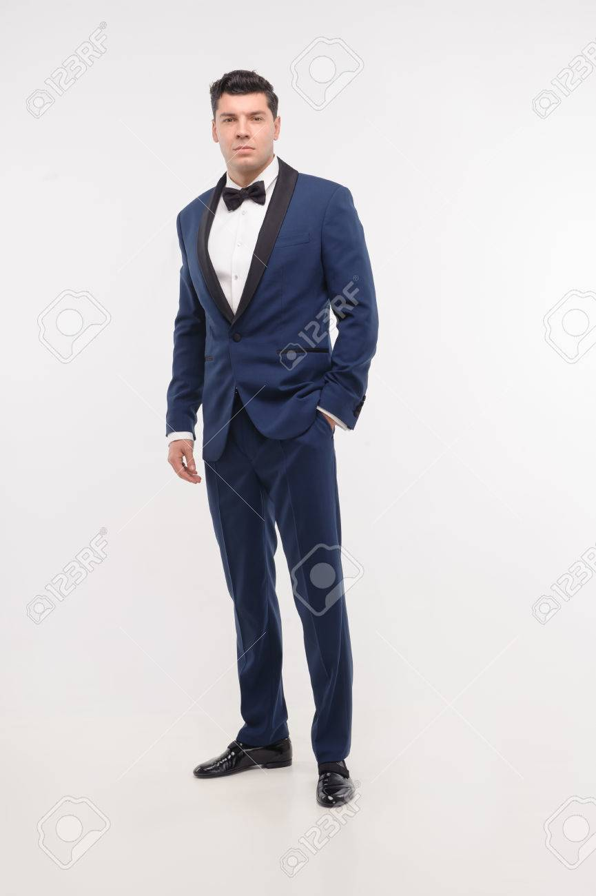 Full Length Portrait Of Young Handsome Man In Blue Suit And