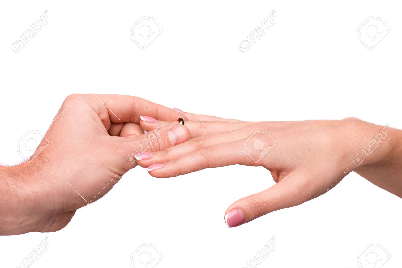 Man Putting A Wedding Ring On Her Finger Stock Photo Picture And
