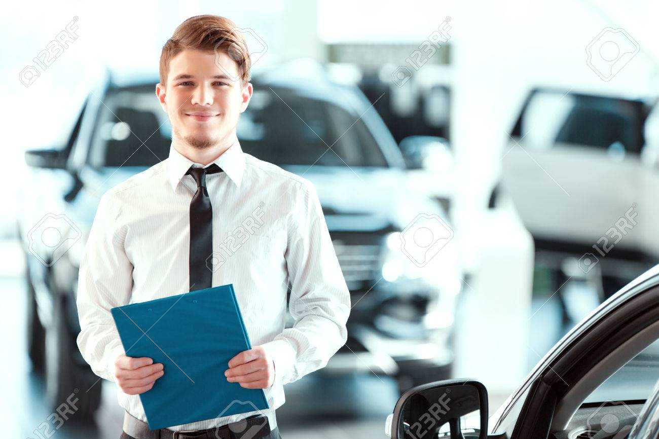 assistant in vehicle search portrait of a handsome young car assistant in vehicle search portrait of a handsome young car s man in formalwear holding