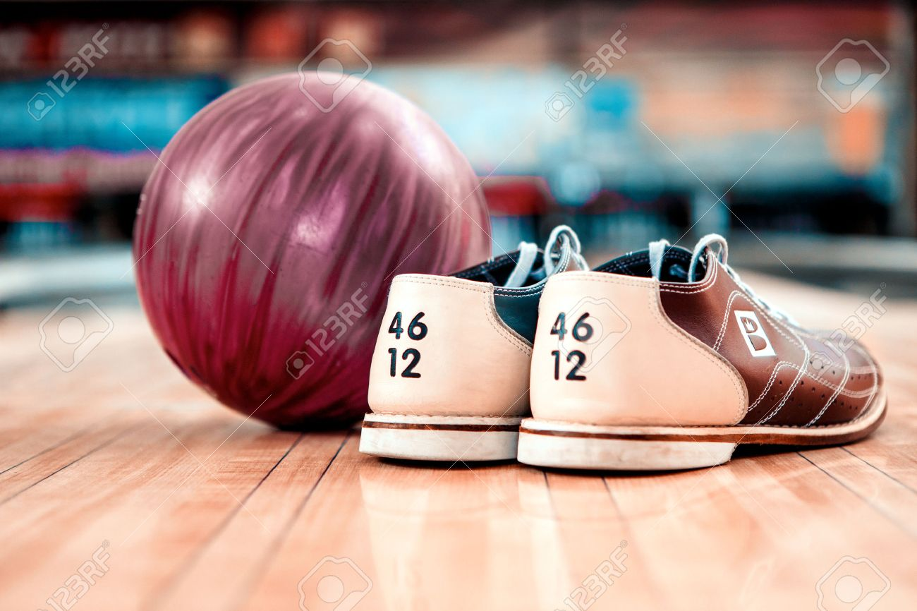 Close Up Of Bowling Shoes And Lilac Ball Lying On Bowling Alley ...