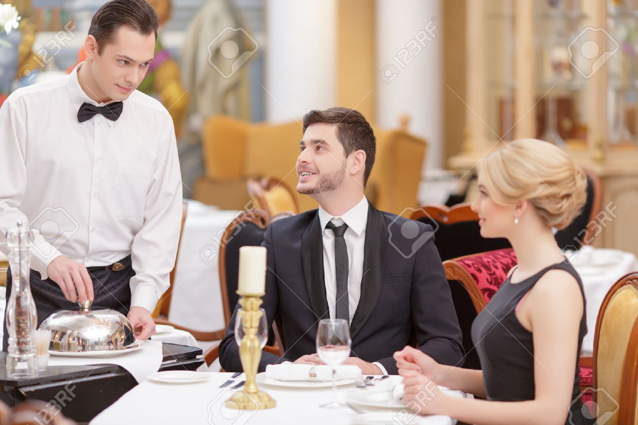 Couple In Restaurant Confident Waiter Serving The Table With Stock Photo Picture And Royalty Free Image Image 37344047