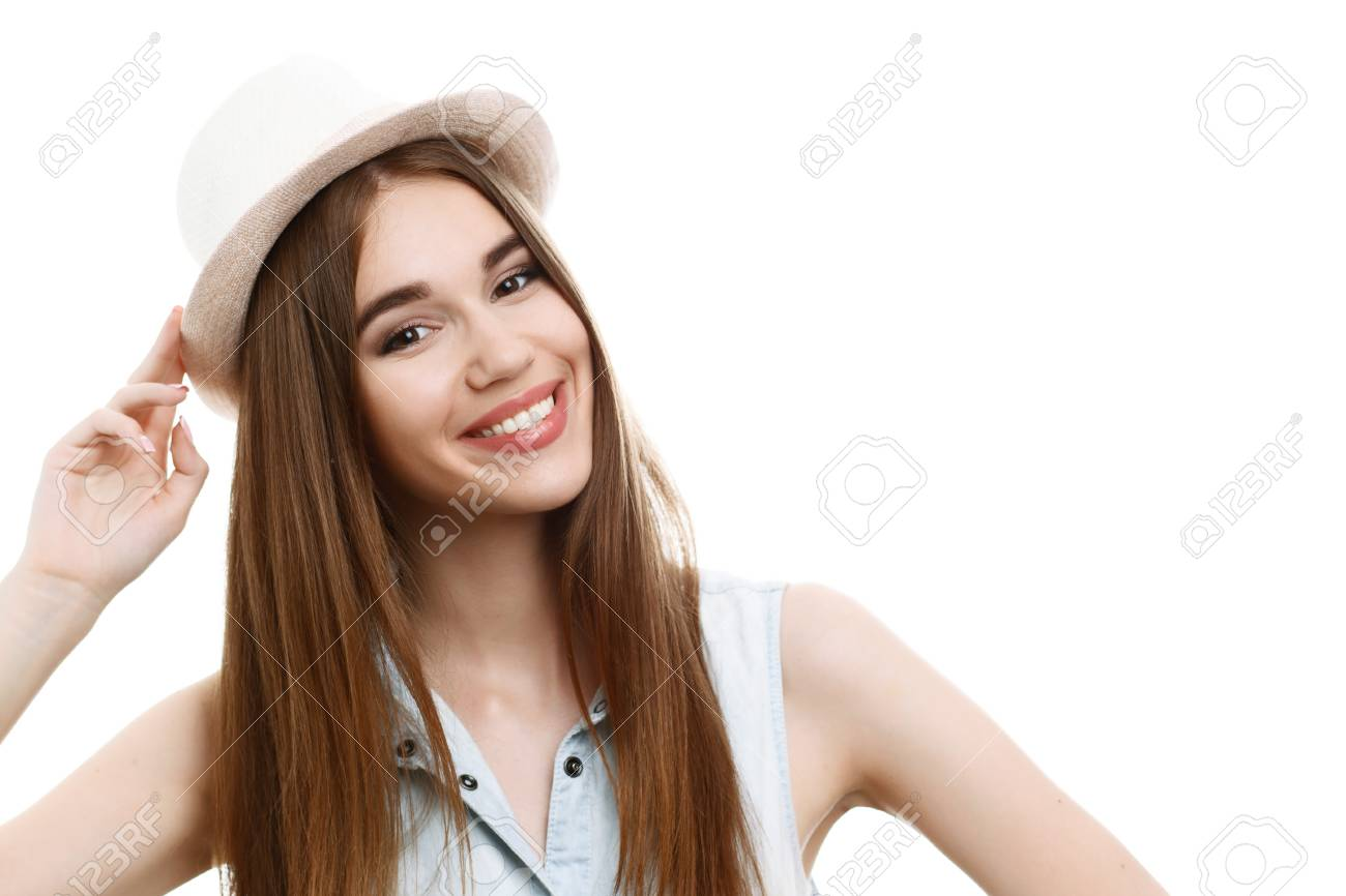 15ae3bad4c8a3 Portrait of a young beautiful girl with long brown hair wearing blue denim  blouse, smiling