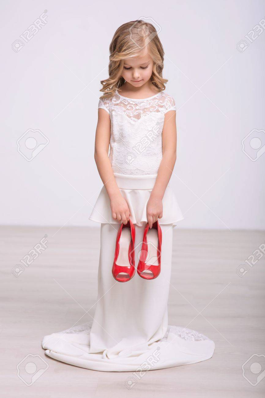 My Size Pleasant Little Girl In A Wedding Dress Holding Red Stock