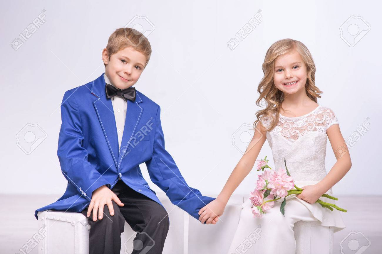 Happy Moment Pleasant Loving Little Boy And Girl Holding Hands