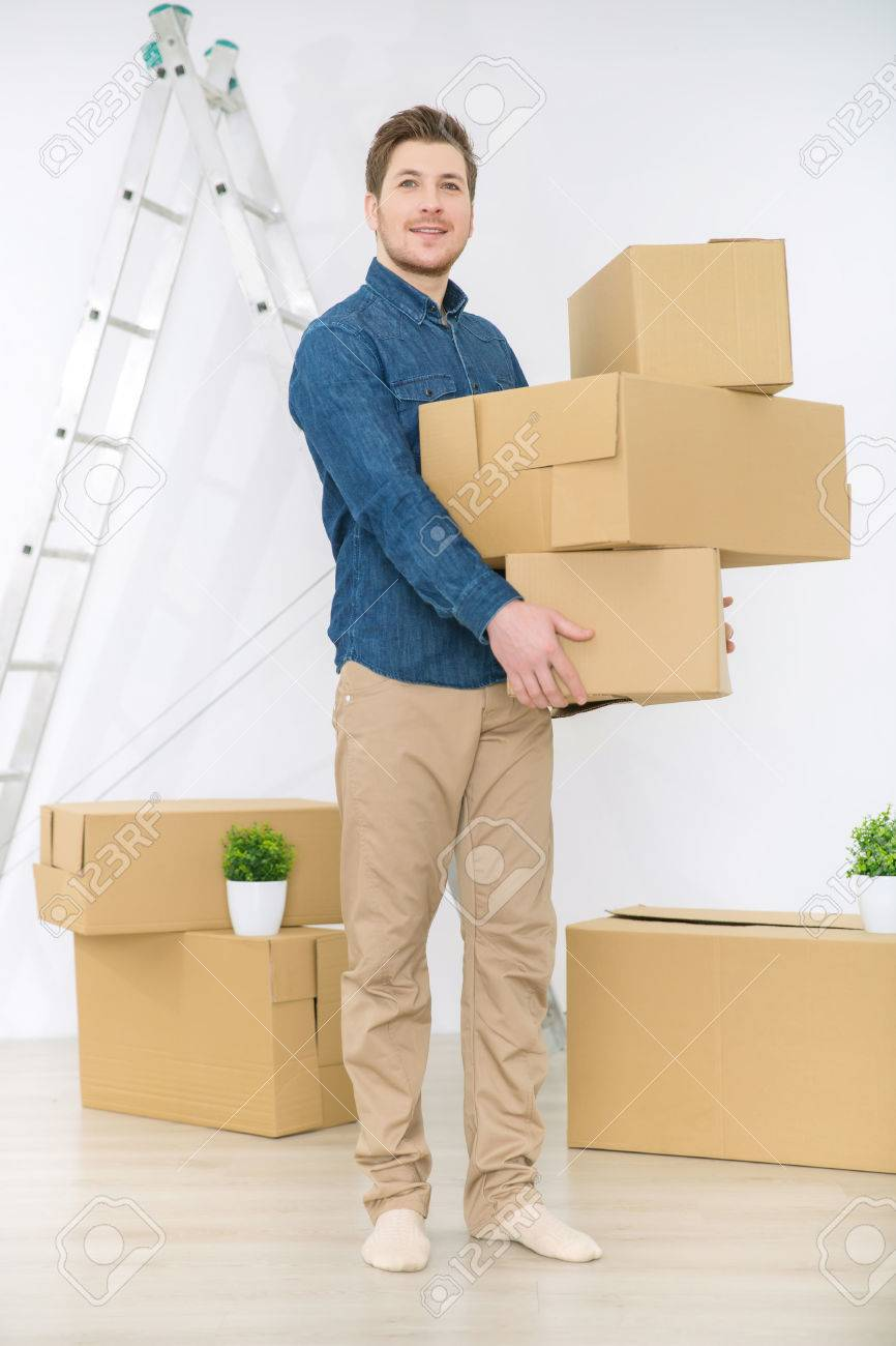 d1b0fd904a7f Photo lets make changes full length of happy handsome man holding boxes and  standing in the