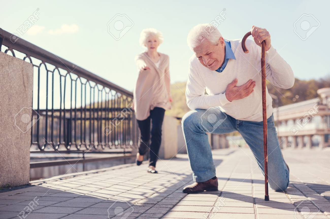 Senior man having a heart attack in the street - 88202204