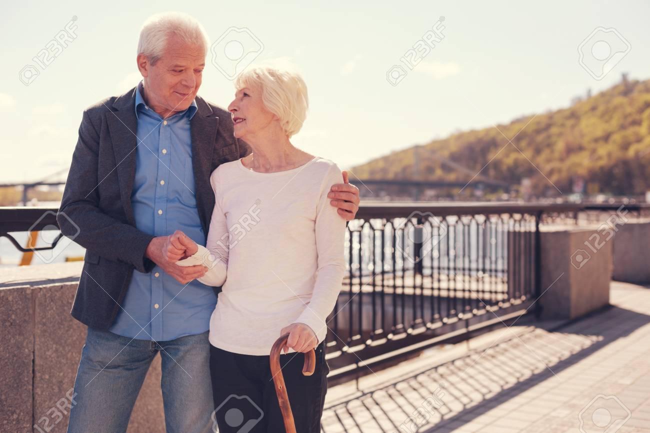 Lovely senior couple bonding on the bridge - 88202283