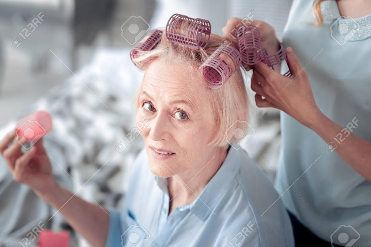 New Hairstyle. Pleasant Nice Elderly Woman Wearing Hair Rollers ...