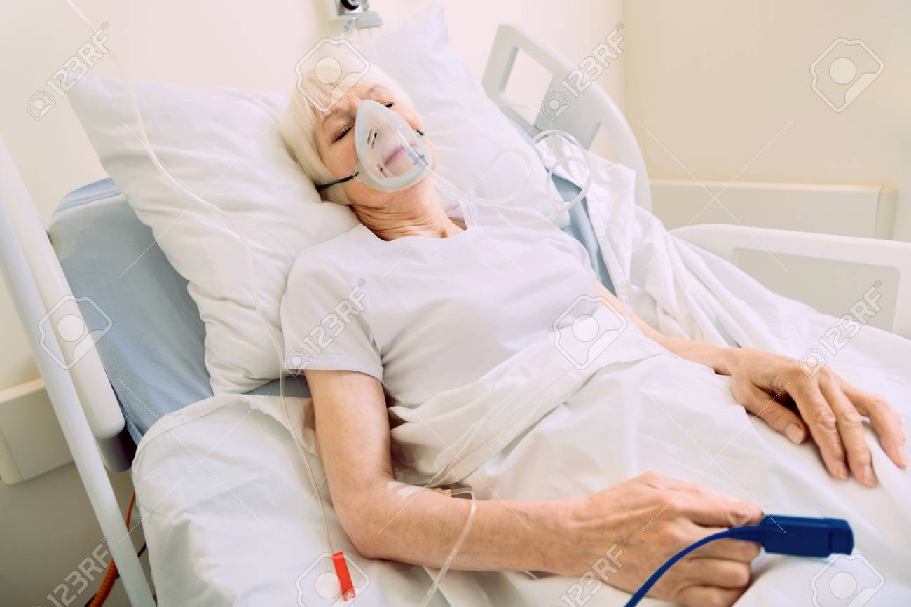 Serious health problem  Poor elderly woman lying in a hospital