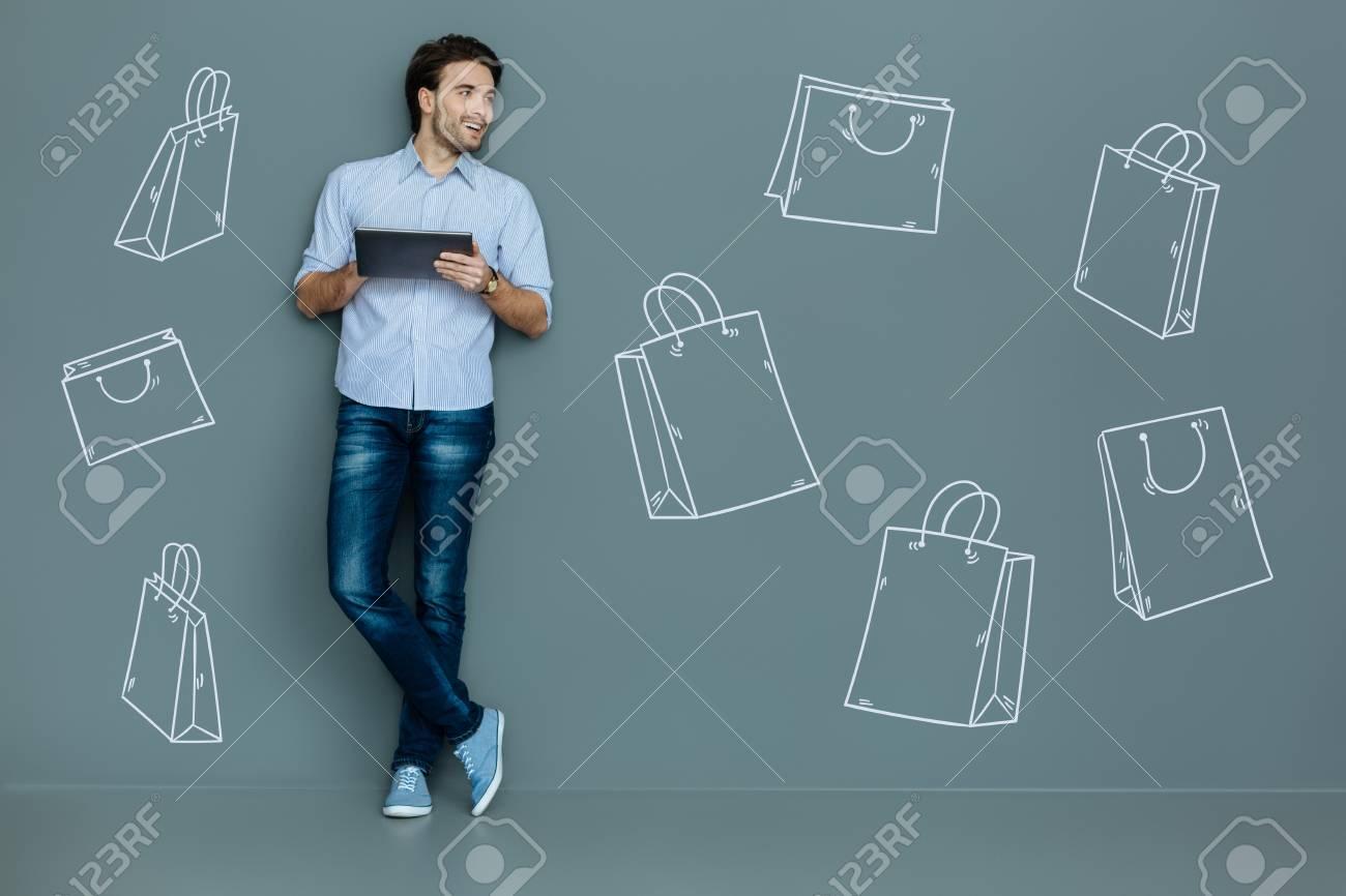 Online Shopping. Positive Busy Man Feeling Good And Smiling While ...