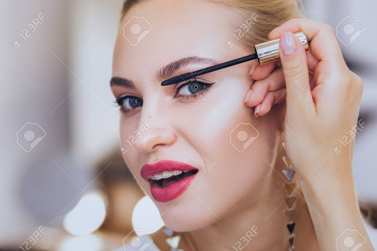 Coloring Eyelashes. Blonde-haired Appealing Woman With Dental ...