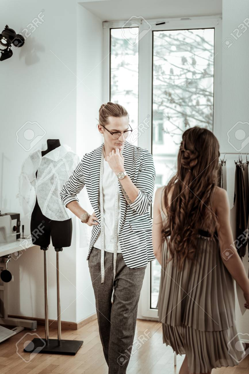 Last Look Long Haired Fashion Designer In Eyeglasses Looking Stock Photo Picture And Royalty Free Image Image 114148619